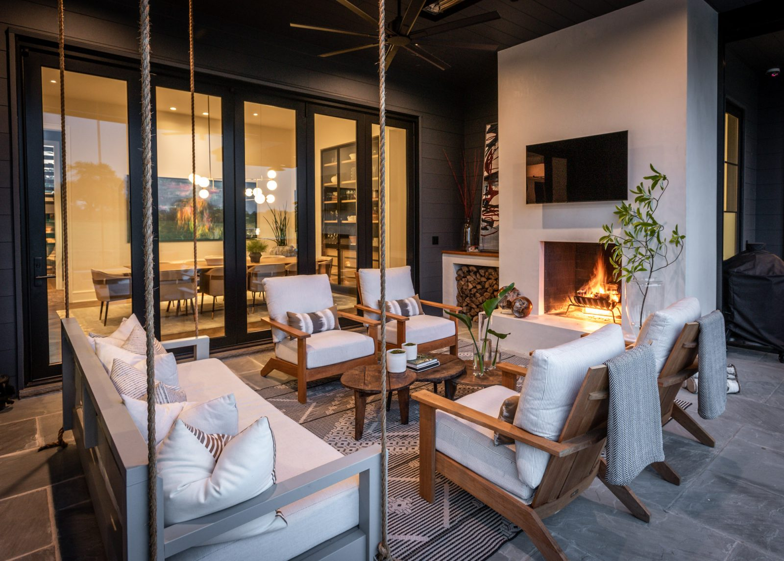 Covered patio outdoor design by marie-joe bouffard of jfy designs white outdoor chairs, porch swing outdoor sitting area fire place
